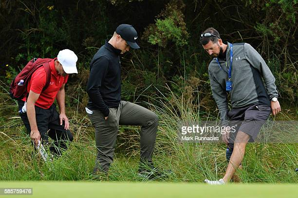Oliver Fisher of England looks for his ball in the deep rough on hole 18 on day one of the Aberdeen Asset Management Paul Lawrie Matchplay at...