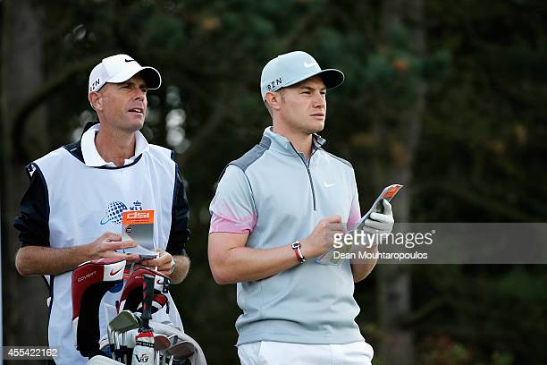 Oliver Fisher of England looks on before he hits his tee shot on the 11th hole during the Final Round of the KLM Open held at De Kennemer Golf and...