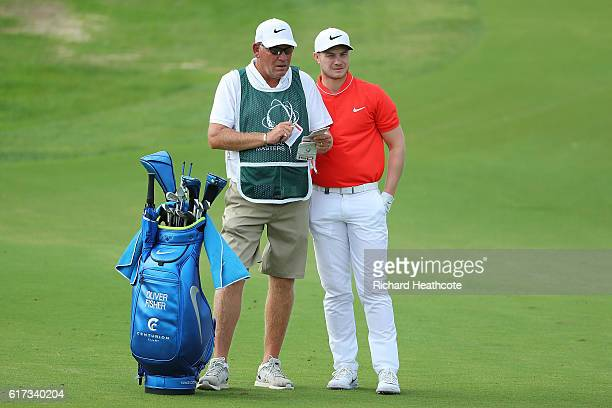 Oliver Fisher of England looks on with his caddie during day four of the Portugal Masters at Victoria Clube de Golfe on October 23 2016 in Vilamoura...