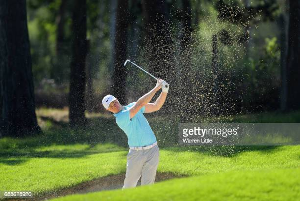 Oliver Fisher of England plays from a bunker on the 9th hole during day two of the BMW PGA Championship at Wentworth on May 26 2017 in Virginia Water...