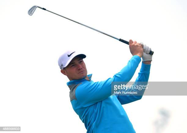 Oliver Fisher of England plays his approach shot to the 18th green during the ProAm day at the Madeira Islands Open at Club de Golf do Santo da Serra...