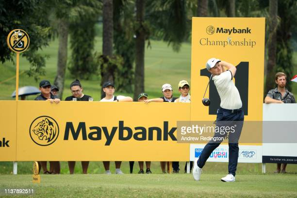 Oliver Fisher of England plays his shot off the 11th tee during Day Four of the Maybank Championship at Saujana Golf Country Club Palm Course on...