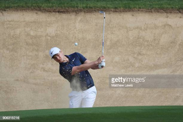 Oliver Fisher of England plays his third shot from a bunker on the second hole during round one of the Abu Dhabi HSBC Golf Championship at Abu Dhabi...