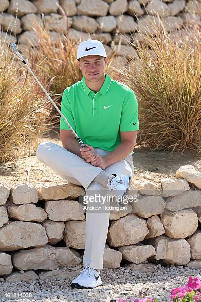 Oliver Fisher of England poses for a portrait during the ProAm prior to the start of the Commercial Bank Qatar Masters at Doha Golf Club on January...