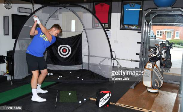 Oliver Fisher of England practices at home on May 04, 2020 in Binfield, England. The European Tour has suspended golf events for the foreseeable...
