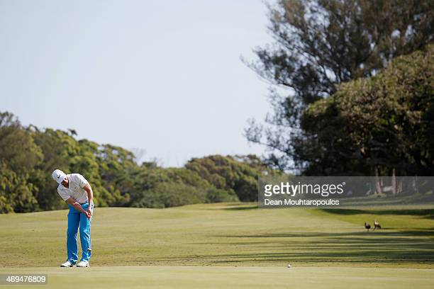 Oliver Fisher of England putts on the 15th green during Day 3 of the Africa Open at East London Golf Club on February 15 2014 in East London South...