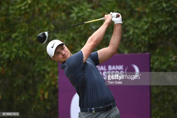 Oliver Fisher of England tees off on the 6th hole during the third round of the Commercial Bank Qatar Masters at Doha Golf Club on February 24 2018...