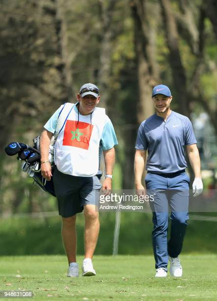 Oliver Fisher of England walks down the 18th fairway with his caddy during Day One of the Trophee Hassan II at Royal Golf Dar Es Salam on April 19...