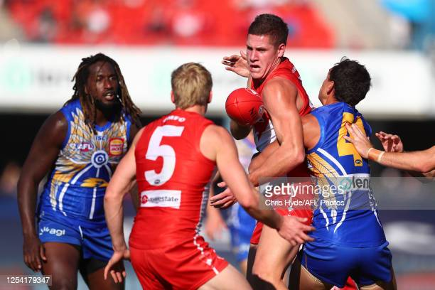 Oliver Florent and Hayden Mclean of the Swans handballs during the round 5 AFL match between the West Coast Eagles and the Sydney Swans at Metricon...