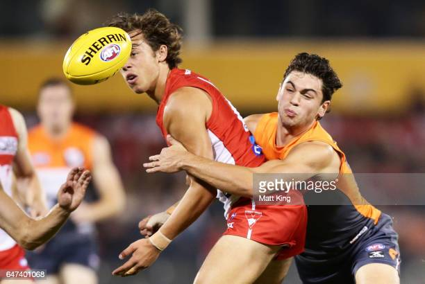 Oliver Florent of the Swans is challenged by Tim Taranto of the Giants during the 2017 JLT Community Series AFL match between the Greater Western...
