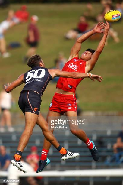 Oliver Florent of the Swans marks under pressure from Sam Reid of the Giants during the AFL Inter Club match between the Sydney Swans and the Greater...