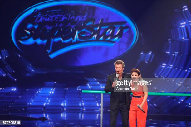 Oliver Geissen and Maria Voskania speak on stage during the finals of the tv competition 'Deutschland sucht den Superstar' at Coloneum on May 6 2017...