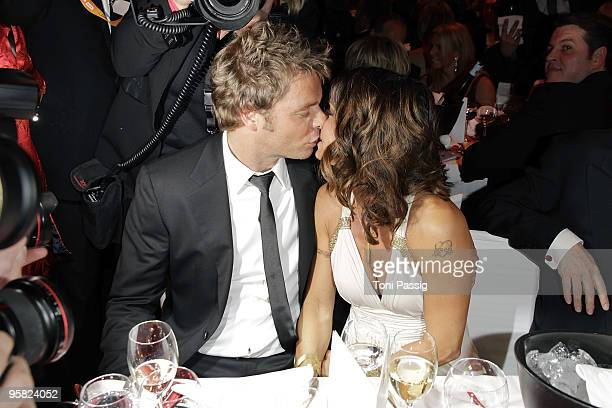 Oliver Geissen kissing his wife Christina Plate attend the 37 th German Filmball 2010 at the hotel Bayrischer Hof on January 16 2010 in Munich Germany