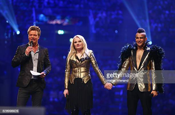 Oliver Geissen Laura van den Elzen and Prince Damien are waiting for the final decision about the winner during the finals of the television show...