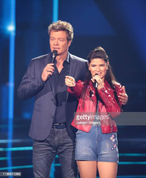 Oliver Geissen stands beside Joana Kesenci during the second event show of the tv competition Deutschland sucht den Superstar at Coloneum on April 13...