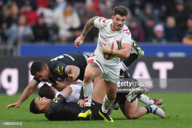 Oliver Gildart of England breaks away to score the winning try during the International Series match between England and New Zealand at KCOM Stadium...