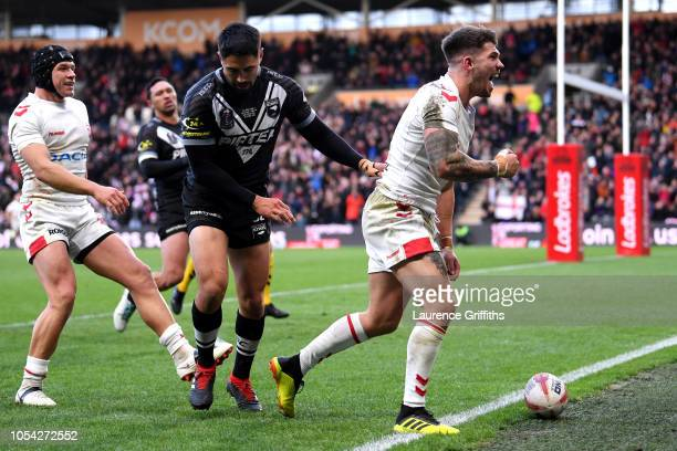 Oliver Gildart of England celebrates after scoring his team's second try during the International Series match between England and New Zealand at...