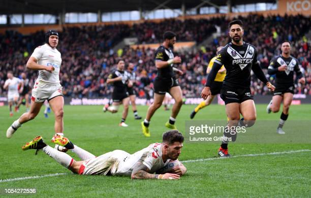 Oliver Gildart of England scores his team's second try during the International Series match between England and New Zealand at KCOM Stadium on...