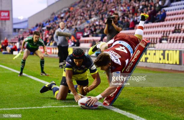 Oliver Gildart of Wigan Warrirors scores the first try of the game during the BetFred Super League match between Wigan Warriors and Wakefield Trinity...