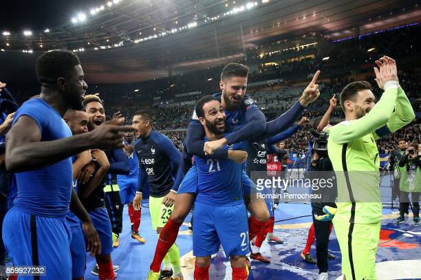 Oliver Giroud and Adil Rami of France wave fans after the FIFA 2018 World Cup Qualifier between France and Belarus at Stade de France on October 10...