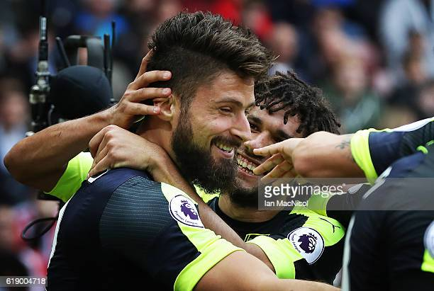Oliver Giroud of Arsenal celebrates after he scores his second goal during the Premier League match between Sunderland and Arsenal at Stadium of...