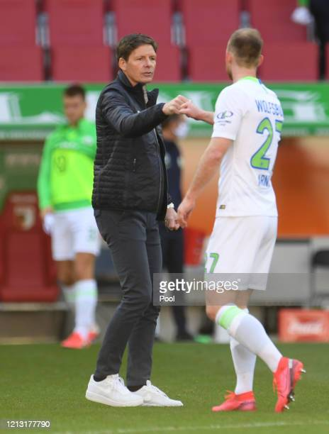 Oliver Glasner, Head Coach of VfL Wolfsburg celebrates with Daniel Ginczek following their victory in the Bundesliga match between FC Augsburg and...