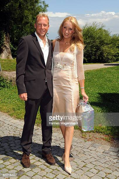 Oliver Gross and Renata Kochta attend the wedding of Designer Sarah Kern and Goran Munizaba at Blutenburg Castle on August 8 2008 in Munich Germany...