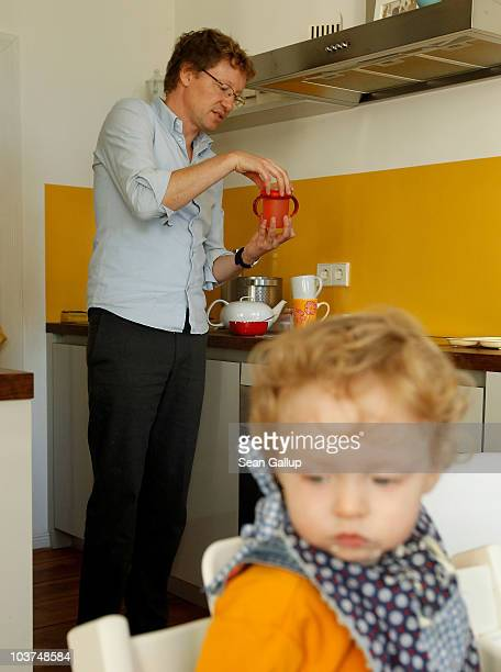 Oliver H. A married federal employee on 6-month paternity leave, prepares breakfast for his twin 14-month-old daughters Lotte and Alma at his home on...