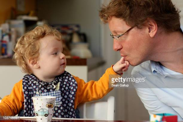Oliver H. A married federal employee on 6-month paternity leave, plays with one of his 14-month-old daughters, Lotte, during breakfast at his home on...