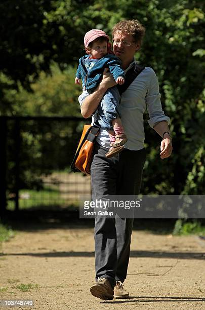 Oliver H. A married federal employee on 6-month paternity leave, plays with his twin 14-month-old daughter Lotte at a playground near his home on...