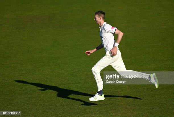 Oliver Hannon-Dalby of Warwickshire runs into bowl during the LV= Insurance County Championship match between Warwickshire and Essex at Edgbaston on...