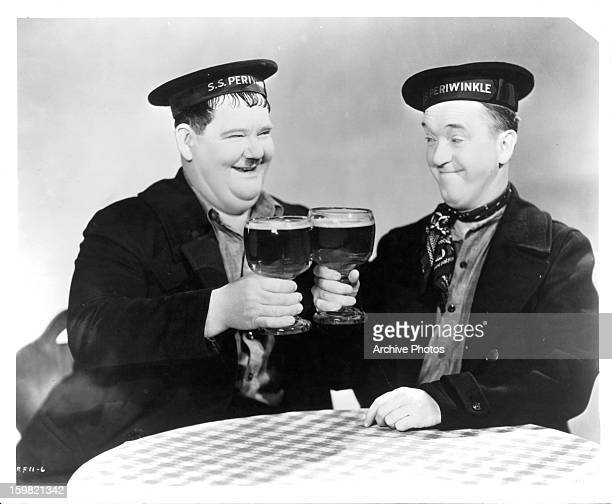 Oliver Hardy and Stan Laurel having beer in a scene from the film 'Our Relations' 1936