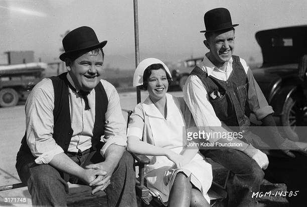 Oliver Hardy and Stan Laurel with Dorothy Coburn during the filming of 'The Finishing Touch' directed by Leo McCarey and Clyde Bruckman