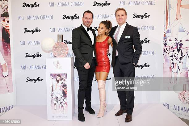 Oliver Hedfeld of Douglas Ariana Grande and Thomas Eichhorn of Douglas attend the Exclusive Meet Greet With Ariana Grande At Douglas on November 06...