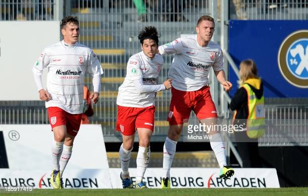 Oliver Hein of Regensburg celebrates with team-mates after scoring his team's second goal during the Third League match between Jahn Regensburg and...