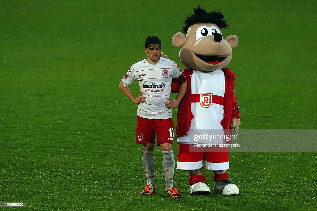 Oliver Hein of Regensburg reacts with team mascot Jahn after the Second Bundesligamatch between Jahn Regensburg and FC Ingolstadt at Jahnstadion on April 19, 2013 in Regensburg, Germany.