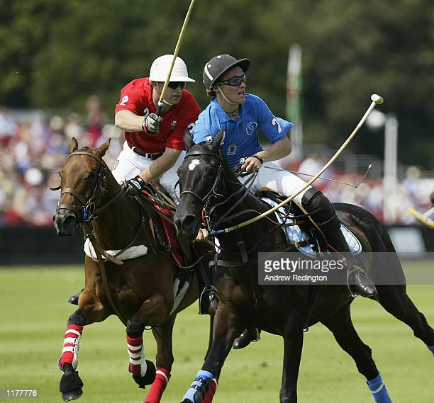 Oliver Hipwood of the Prince of Wales team and Satnam Dhillon of the Hurlingham team in action during the Cartier International Polo Day played at...