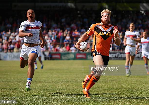 Oliver Holmes of Castleford Tigers breaks away to score their fourth try during the First Utility Super League match between Wakefield Trinity...