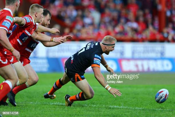 Oliver Holmes of Castleford Tigers loses the ball during the Roger Millward Trophy match between Hull KR and Castleford Tigers as part of the Betfred...