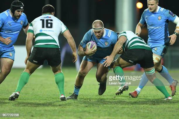 Oliver Hoskins of London Irish is tackled during the European Rugby Challenge Cup match between Krasny Yar and London Irish at Avchala Stadium on...