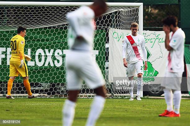 Oliver Huesing of Bremen and team mates react after Mario Kvesic of Aue scored his team's third goal during a friendly match between Werder Bremen...