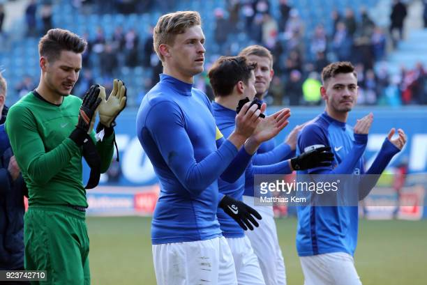 Oliver Huesing of Rostock and his team mates celebrate with their supporters after winning the 3Liga match between FC Hansa Rostock and 1 FC...