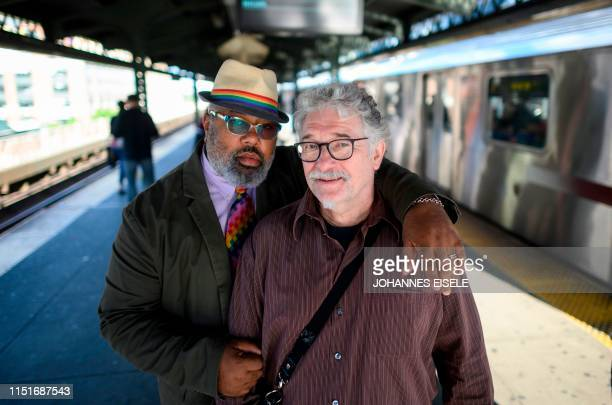 Oliver Hummel and his boyfriend Stanley Reed pose for a picture at a subway stop on June 14, 2019 in New York City. - Oliver Hummel and Stanley Reed...