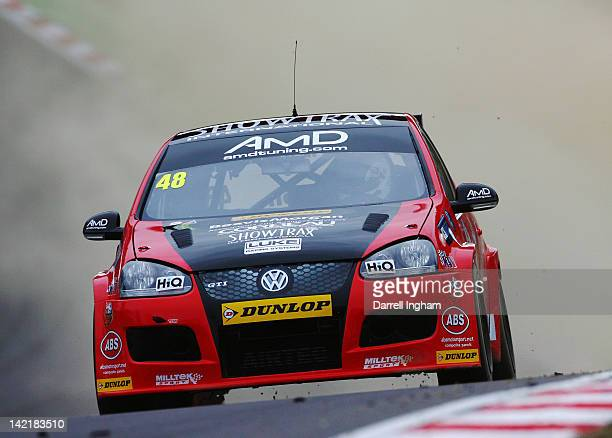 Oliver Jackson of Great Britain drives the AMD Tuning Volkswagen Golf during practice for the Dunlop MSA British Touring Car Championship race at the...