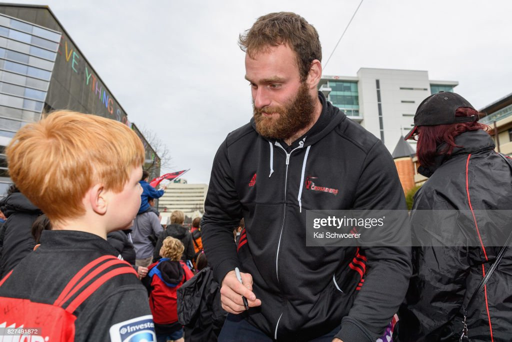 Oliver Jager greets fans during a parade at Christchurch Art Gallery on August 8, 2017 in Christchurch, New Zealand. The Crusaders beat the Lions to win the 2017 Super Rugby Final on Saturday night in Johannesburg.