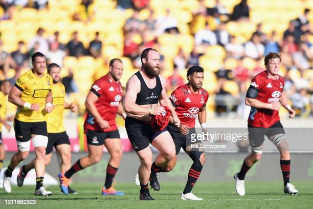 Oliver Jager of the Crusaders tries to get his shirt back on during the round seven Super Rugby Aotearoa match between the Hurricanes and the...