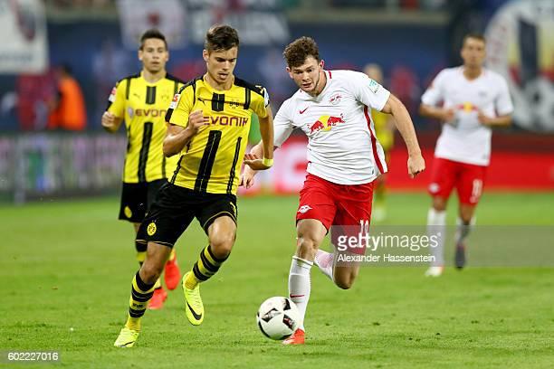Oliver Jason Burke of Leipzig battles for the ball with Julian Weigl of Dortmund during the Bundesliga match between RB Leipzig and Borussia Dortmund...