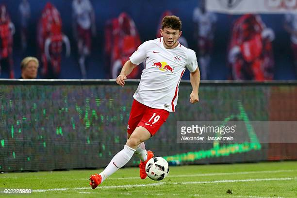 Oliver Jason Burke of Leipzig runs with the ball during the Bundesliga match between RB Leipzig and Borussia Dortmund at Red Bull Arena on September...