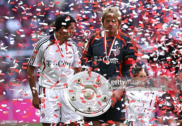 Oliver Kahn and Roy Makaay of Bayern celebrate with the trophy for the German Champion after the Bundesliga match between FC Bayern Munich and...