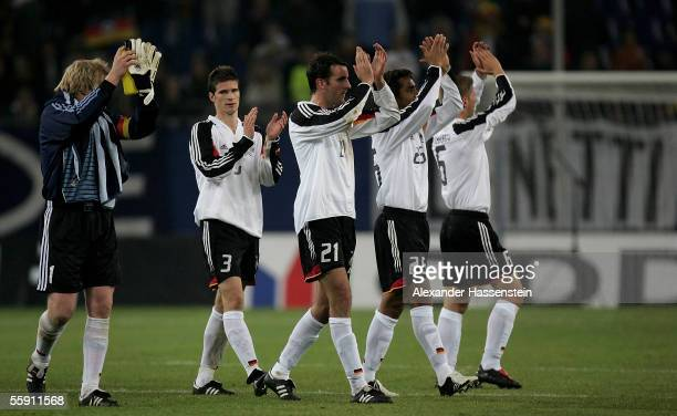 Oliver Kahn, Arne Friedrich, Christoph Metzelder, Patrick Owomoyela and Thomas Hitzlsperger applaud fans after the friendly game between Germany and...